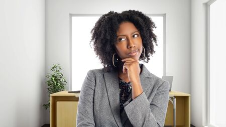 Black African American businesswoman in an office thinking of ideas.  She is an owner or an executive of the workplace.  Depicts careers and startup business. Stock fotó