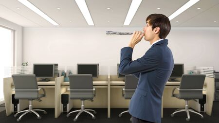 Businessman celebrating by himself alone in the office.  He is happy because of a birthday, holiday or a successful job and a pay raise.  Depicts business and success.