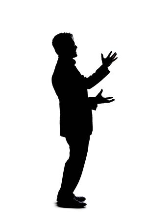Full body silhouette of a businessman isolated on a white background. He is gesturing like he is talking or speaking to someone Stock Photo