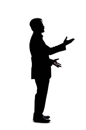 Full body silhouette of a businessman isolated on a white background. He is gesturing like he is talking or speaking to someone Banque d'images