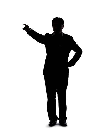 Full body silhouette of a businessman isolated on a white background. He is pointing at copy or text space like he is advertising or promoting something.