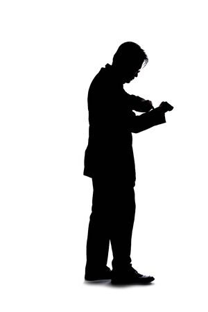 Full body silhouette of a businessman isolated on a white background. He is standing and waiting and posed as if bored or impatient.