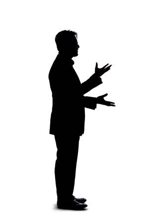 Full body silhouette of a businessman isolated on a white background. He is gesturing like he is talking or speaking to someone 스톡 콘텐츠