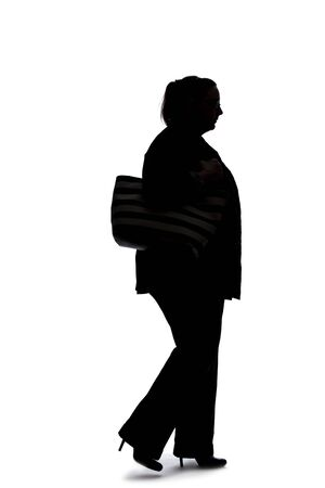 Silhouette of a curvy or plus size businesswoman on a white background. She is posed like she is walking in side view.