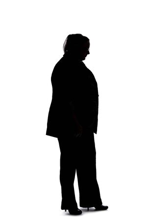 Silhouette of a curvy or plus size businesswoman on a white background. She is posed like she is bored of waiting and standing.