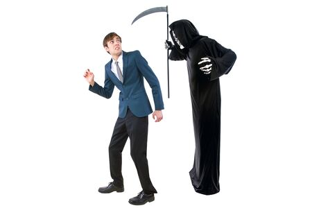 Man in a Halloween grim reaper ghost costume chasing, mocking and making fun of scared businessman running away.  Can also depict death following a man as a metaphor for life insurance. Banque d'images - 132382372