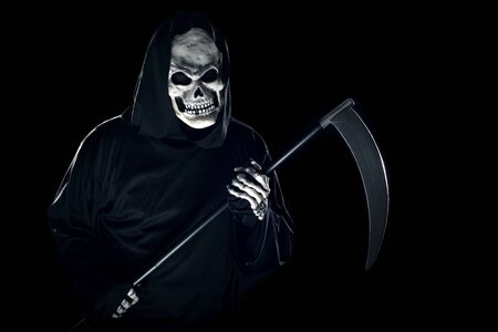 Grim Reaper ghost coming out of the shadows with a scythe or sickle.  The scary demon or monster depicts Halloween and Day of the Dead holiday.
