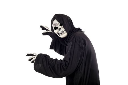 The grim reaper or death halloween costume isolated on a white background.  The skeleton is wearing a hooded black robe. Side view in profile for composites. Stock Photo