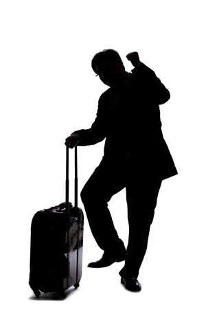 Silhouette of a backlit model posing as a businessman on a white background.  He is gesturing like he is happy or winning