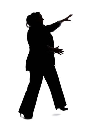 Silhouette of a curvy or plus size businesswoman on a white background for composites.  She is posed like she is falling or off balance