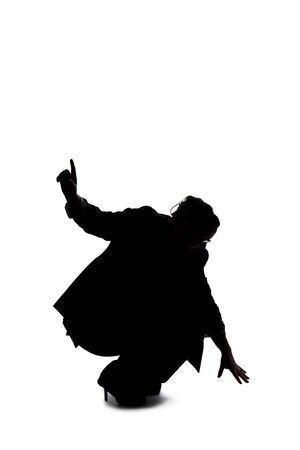 Silhouette of a curvy or plus size businesswoman on a white background for composites. She is looking for something on the ground