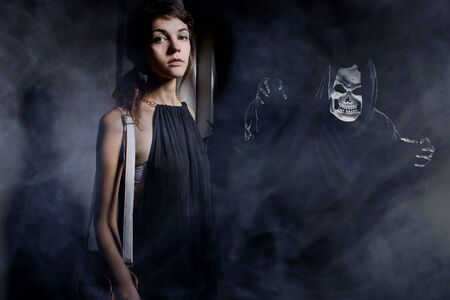 Woman in a dark alley with fog or mist imagining or seeing a demon or ghost.  Depicts a horrifying nightmare or hallucinations due to mental illness