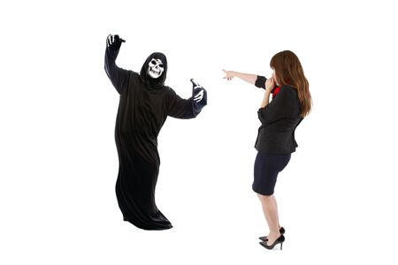 Scared businesswoman paranoid of catching a deadly disease represented by the grim reaper.  She is frightened of contracting a pandemic illness such as coronavirus