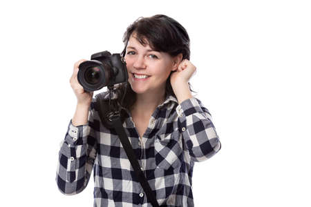 Young female freelance professional photographer or art student or photojournalist on a white background holding a camera with thumbs down