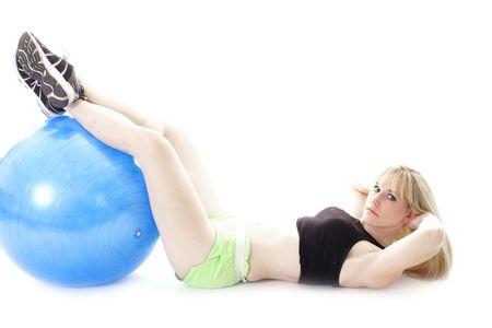 woman resting feet on ball photo