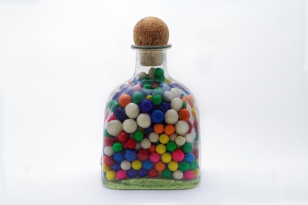 The gumballs held in the glass bottle  waiting to be released be some young child that has just completed his chores.  This should be the reward for all good children who their chores. photo