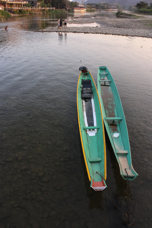 green boat: Two green boat in the river