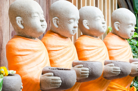 Robe: Buddhist Monk Statues with Orange Robe Stock Photo