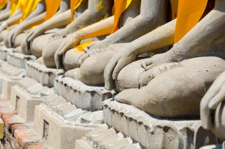 chaimongkol: Hand of Aligned Sitting Buddha Statues at Wat Yai Chaimongkol in  Ayutthaya, Thailand Stock Photo
