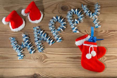 botas de navidad: Santa Claus hat and boots on  wooden boards christmas background