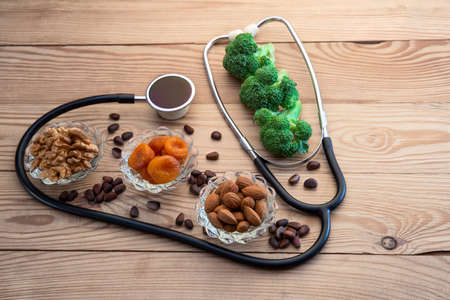 Healthy food in heart and healthy heart concept on boards