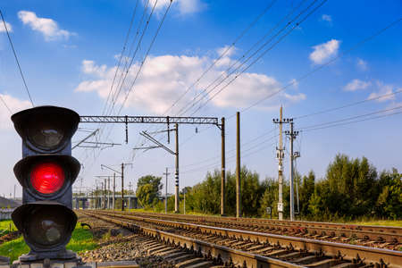 Semaphore on railway. The blue sky, the sun. Stock Photo
