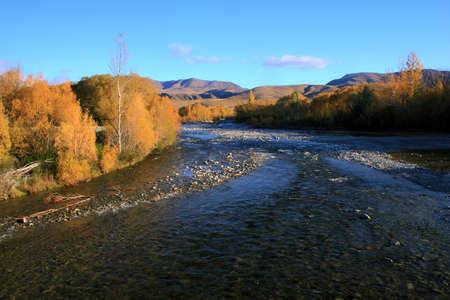 rive: Autumn mountain vista down the Otematata River, Waitaki valley, New Zealand