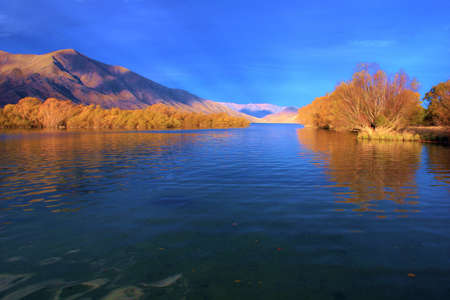 vista: Autumn mountain vista across Lake Benmore, Waitaki valley, New Zealand