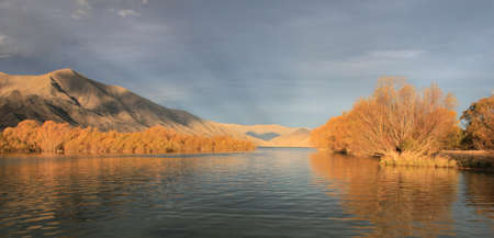 Autumn mountain vista across Lake Benmore, Waitaki valley, New Zealand photo