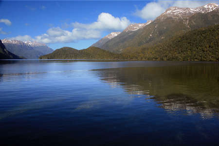 Mountain vista across Lake Manapouri, Fiordland National Park, New Zealand photo