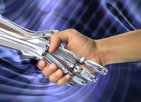 Robot and human handshake.  Friendship between high technology and people