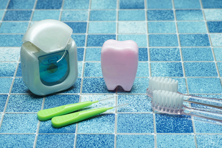 Tooth and brushand dental floss
