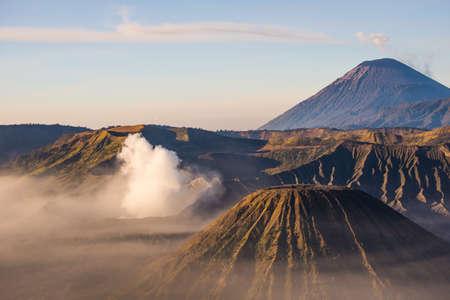 otherworldly: Gunung Bromo, Mount Batok and Gunung Semeru seen from Mount Penanjakan in Java, Indonesia. Stock Photo