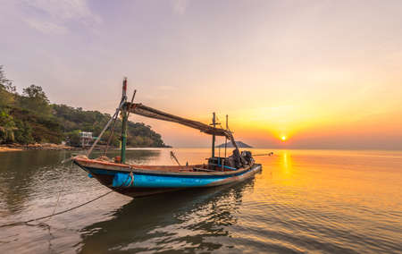 A small boat in sunset time at Ao Yang Beach,Chanthaburi,Thailand