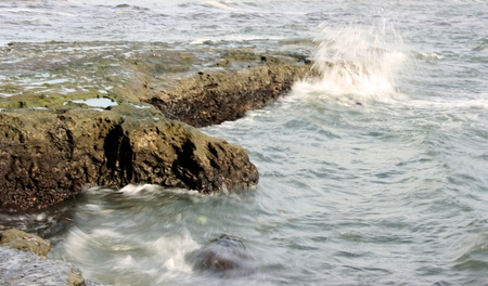 Wave on a rocky seas Stock Photo - 9837496