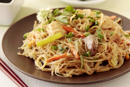 Oriental cuisine Chinese noodles on plate with garnishing photo