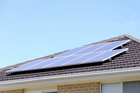 Solar panel on roof that supplies house electricity consumption photo