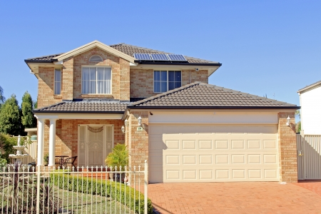 panel: Typical residential house building with solar panel on the roof Editorial
