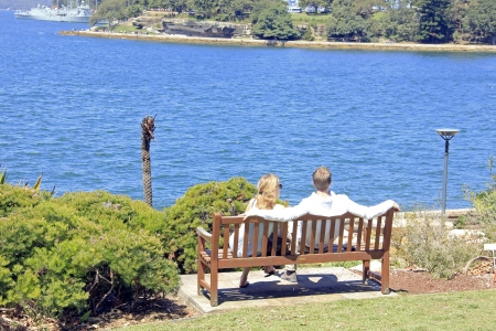 25 29 years: Lovers setting in the bench of an island paradise