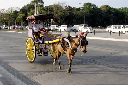 manila: A calesa in a tourist areain Manila.