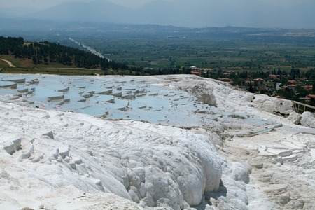 Travertine pools and terraces in Pamukkale. / Pamukkale, a natural site in Denizli in southwestern Turkey.