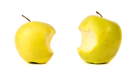 bitten: Bitten yellow green apples isolated