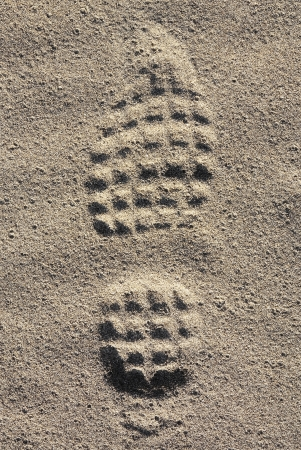 A footmark in the sea sand  photo
