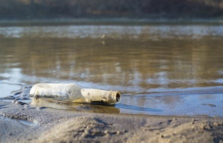 A bottle message in the coastal sand  photo