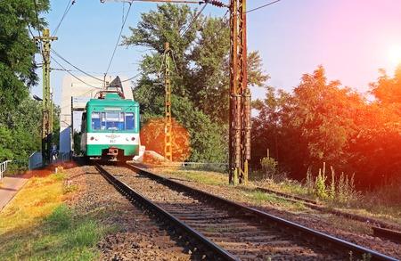 suburban: A green suburban railway runs into the city