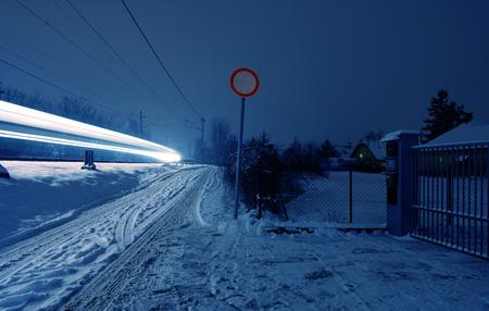winter night: Winter night with a train light strip Stock Photo