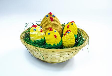 brood: A brood of crochet chickens in a wicker basket.