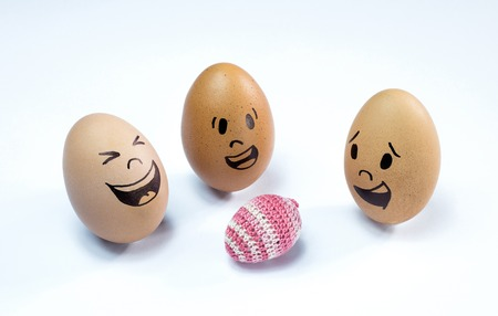 Egg faces are around an easter egg.
