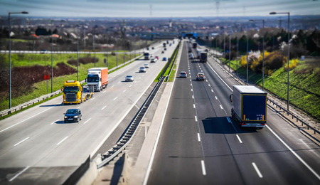 Highway transportation with cars and truck in tiltshift view. Banco de Imagens