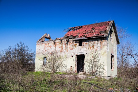 A strongly ruined house outskirts of the town.